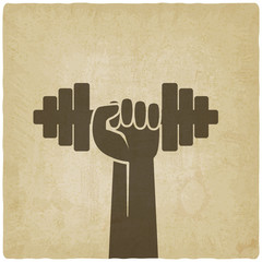 hand with dumbbell. fitness symbol on old background