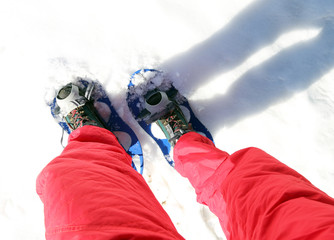 Legs of People while snowshoeing in the mountains