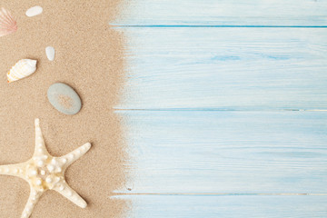 Sea sand with starfish and shells