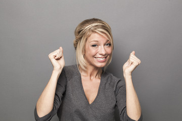 sexy 20s blonde woman smiling for success