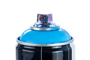 Close-up of a blue spray paint can with used and painty nozzle, isolated on white background.