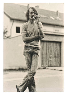 Vintage photo from young fashion smoking man