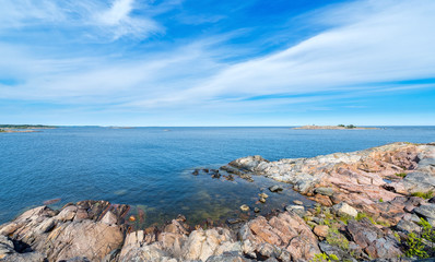 Rocky coastline in vivid colors during a beautiful summer day