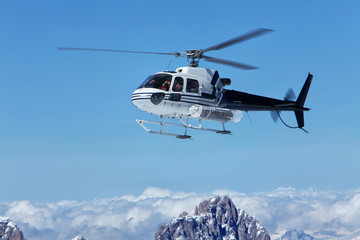 Scenic helicopter flies over the tops of the Marmolada, in front of the rope to the top of the cab. Italy