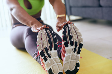 Home Fitness Black Woman Doing Workout Stretching On Pad