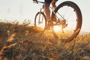 low angle view of cyclist riding with mountain bike on trail at Fototapete