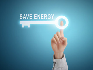 male hand pressing save energy key button