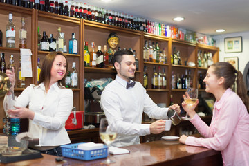 Female drinking wine at counter