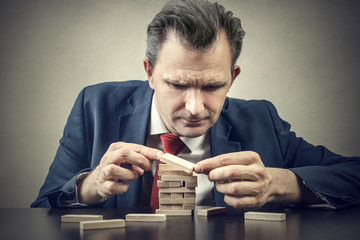 Businessman playing a board game