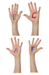 Alphabet (letters) painted on children hands.  Rises up hands.