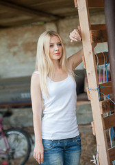 Shot of beautiful girl near an old wooden fence