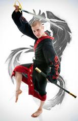 Man dressed in black dragon kimono demonstrating martial arts co