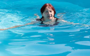 Senior active woman swimming