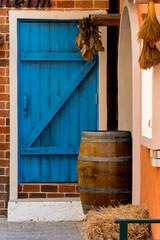 wood door with brick wall