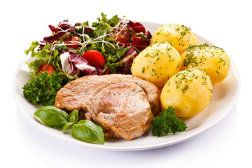 Fried steak, boiled potatoes and vegetable salad