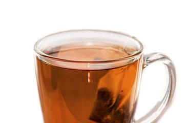 Tea and tea bag in a glass tea cup