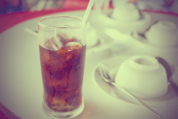 Soft drink on the table - vintage effect