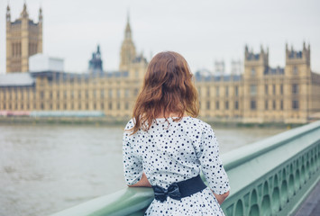 Woman on bridge at houses of parliament