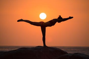 Warrior pose on sunset