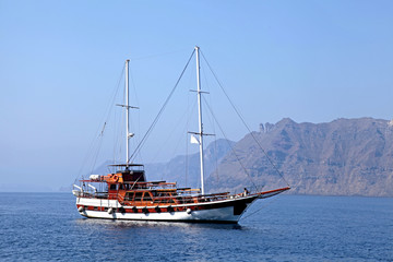 Old classic wooden sailboat in Santorini island, Greece