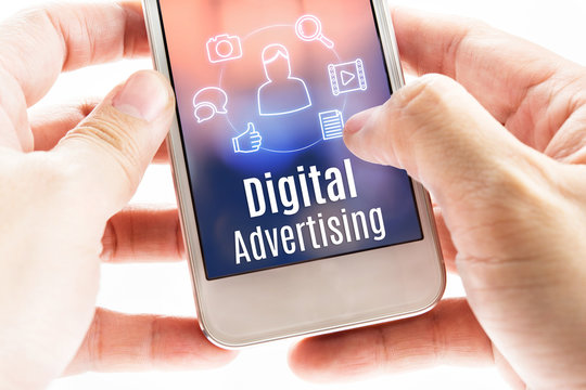 Close up hand holding mobile with Digital Advertising and icons,