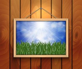 Picture with green grass, sky and cloud