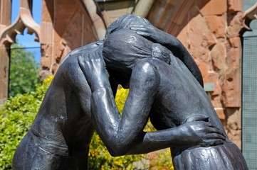 Reconciliation statue in Coventry Cathedral ruin.