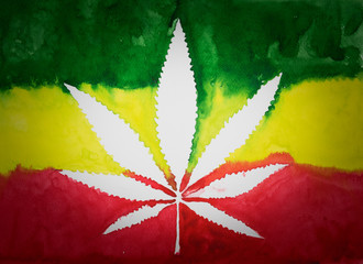 Negative space of cannabis leaf on  rastafarian flag background,watercolor