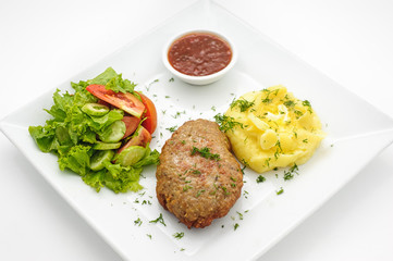 Russian traditional cutlet with mashed potatoes isolated on white