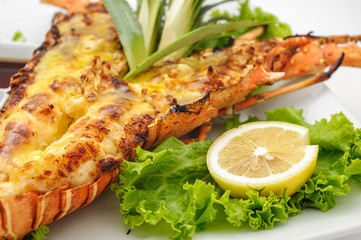 Grilled lobster with lemon isolated on white