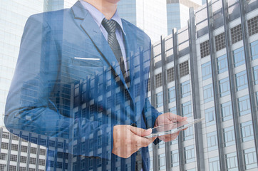 business man holding tablet in hand in blur background