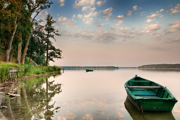 Rowing boat floating over the Lake Elk waters. Masuria, Poland.