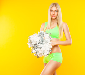 sexy blonde woman - cheerleader on yellow background