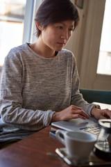 Woman on laptop, coffee break
