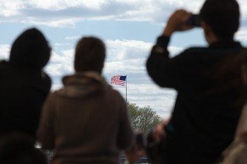 Travelers looking at the US flag