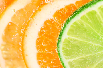 Fototapete - Orange and lime fruit background