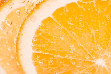 Wall Mural - Orange fruit background with bubbles