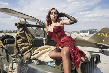 Lady pinup dressed in era of the Second World War, beauty redhea