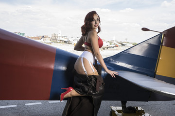 pinup dressed in era of the Second World War, beauty redheaded w