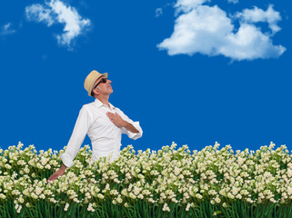 Man walking freely through a field of flowers