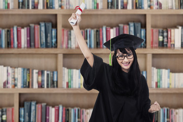 Success student in graduation gown