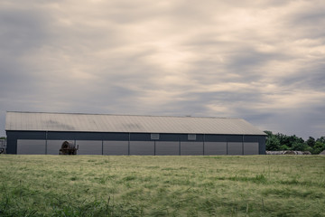 Agriculture barn on a green field