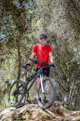 Man with a bike in nature