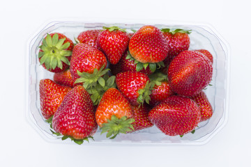 Fresh strawberries, with petioles, on white background.