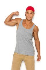 Confident Man Flexing Biceps. Three quarter length studio shot on white background