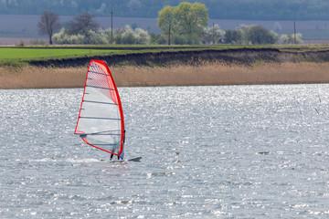 Watersurfer rifing the spring lake