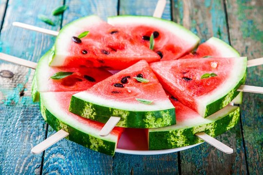 Slices of fresh juicy watermelon on plate closeup