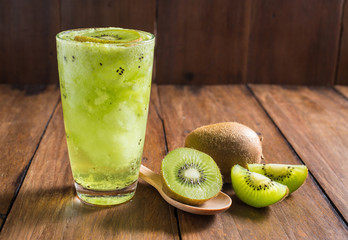 kiwi smoothie with fresh fruits on wooden background