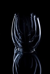 Three oval glasses in a row on black board
