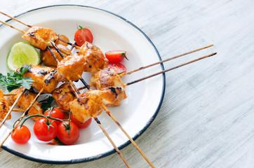 Grilled chicken on sticks with tikka masala sauce